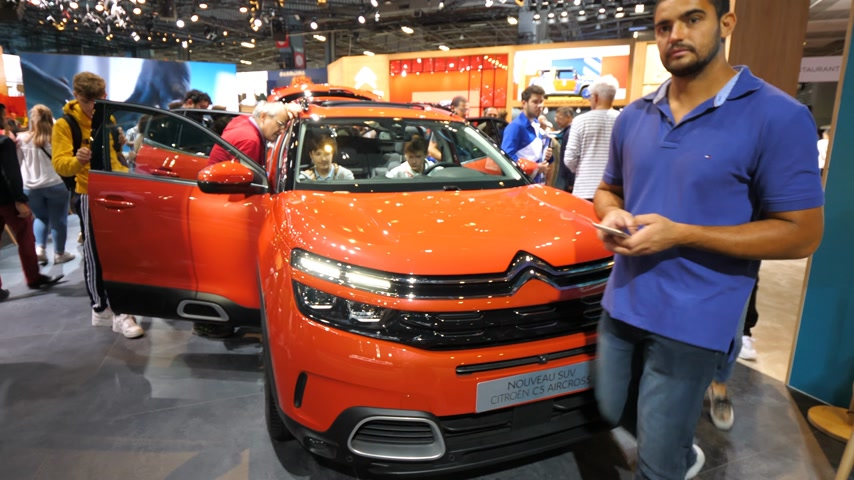 citroen : PARIS, FRANCE - OCT 4, 2018: Customers curious people admiring new new red Citroen SUV c5 Aircross at International car exhibition Mondial Paris Motor Show, rotation on stand
