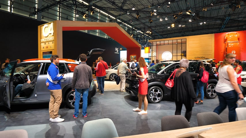 citroen : PARIS, FRANCE - OCT 4, 2018: Customers curious people admiring Citroen French car maker stand at International car exhibition Mondial Paris Motor Show,