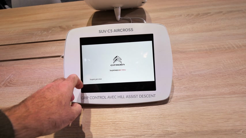 citroen : PARIS, FRANCE - OCT 4, 2018: POV man hand using tablet simulator at from Citroen at International car exhibition Mondial Paris Motor Show,