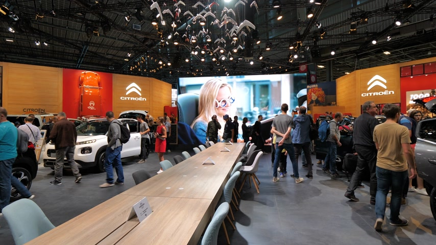 citroen : PARIS, FRANCE - OCT 4, 2018: Pan over customers curious people admiring new luxury  French Citroen cars at International car exhibition Mondial Paris Motor Show,