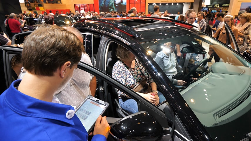 citroen : PARIS, FRANCE - OCT 4, 2018: Customers curious people inside Citroen car being instructed by car seller about the options of the particular model at International car exhibition Mondial Paris Motor Show,