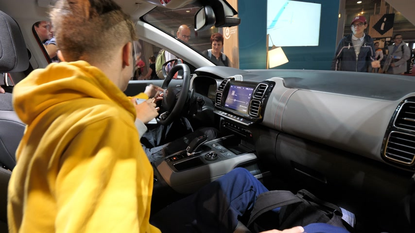 citroen : PARIS, FRANCE - OCT 4, 2018: Young curious boys inside the futuristic car admiring new luxury Citroen SUV c5 Aircross at International car exhibition Mondial Paris Motor Show