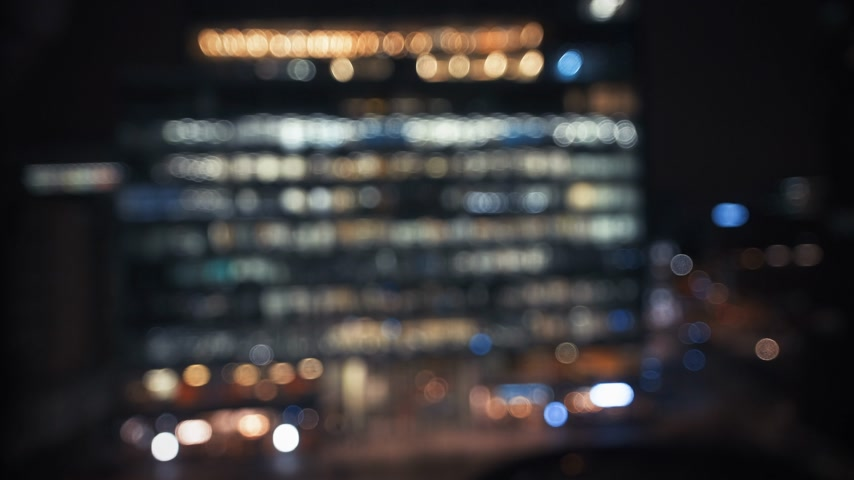 tilt shift : Aerial view of modern building - defocused view with tilt-shift lens of United Kingdom capital, London at night with working late windows in central City business neighborhood