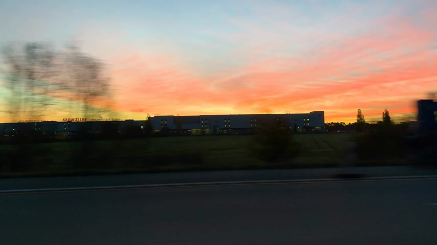 autobahn : Sunrise in Germany view of cars and trucks on autobahn at sunrise early in the morning - commuting early in the morning with heavy traffic time lapse fast motion