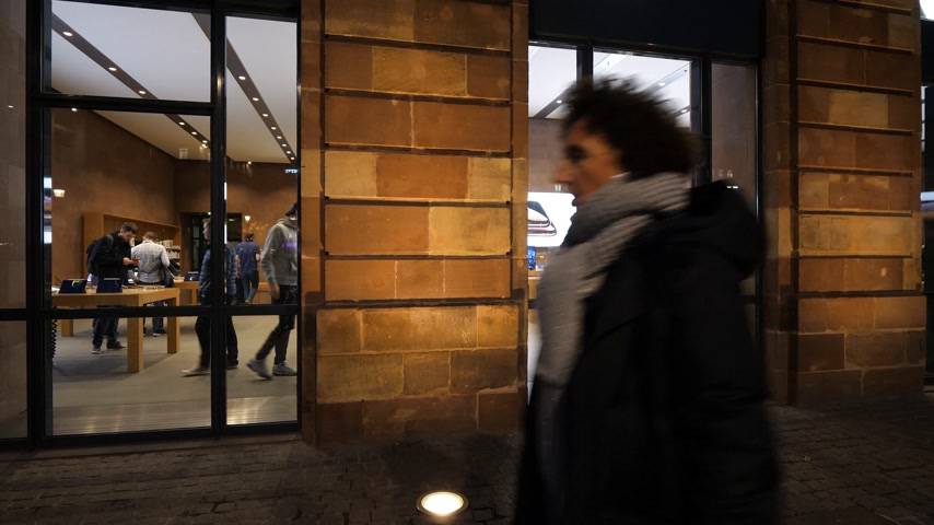 strasbourg : PARIS, FRANCE - NOV 2018: facade of Apple Store in Strasbourg at dusk with people customers walking inside and outside the store during new iPad sales start