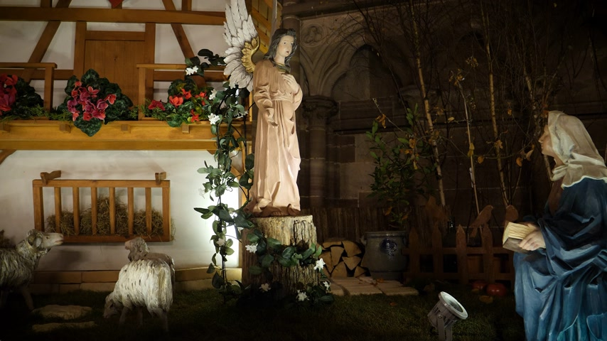jesus born : Nativity manger scene in the Notre-Dame de Strasbourg cathedral during winter holidays season representing the birth of Jesus - featuring