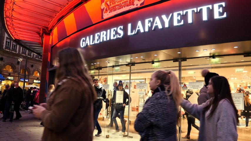 consumerism : STRASBOURG, FRANCE - DEC 23, 2017: Customers shopping in the winter evening a few days before Christmas in France at galleries Lafayette in central Strasbourg - square image