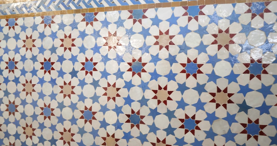 marokkó : Pan from left to right over beautifully crafted arranged pattern of tiles inside the Strasbourg Great Mosque or Grande Mosquee de Strasbourg