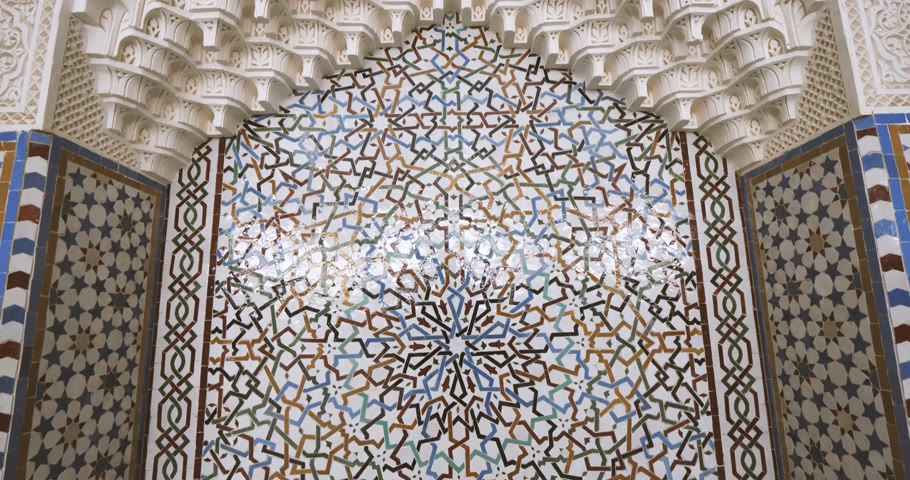 tilt : Tilt-up to the majestic mihrab in Strasbourg Great Mosque or Grande Mosquee de Strasbourg magical flare and sunlight flare beautiful tile pattern