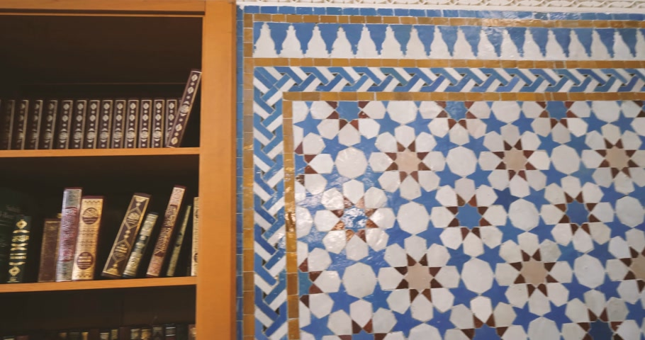 nobreza : Pan to the majestic bookshelf with multiple religious books including the saint Quran in Strasbourg Great Mosque or Grande Mosquee de Strasbourg