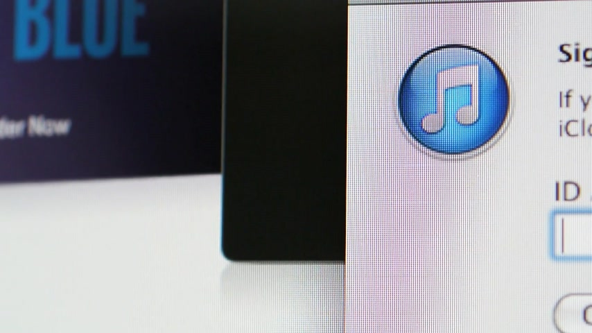 CALIFORNIA, UNITED STATES - CIRCA 2014: Pan to Apple Computers new computer iMac with connection login page to iTunes music organizer software