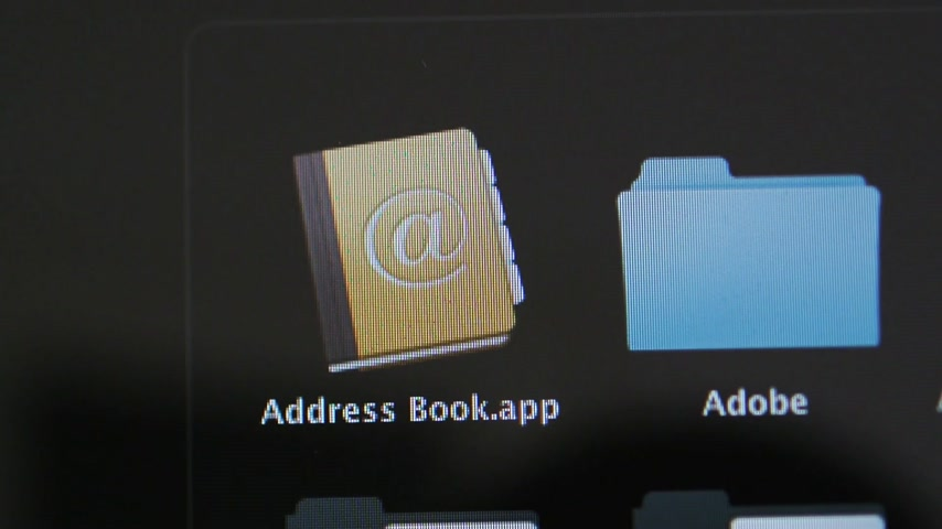 apple sign : CALIFORNIA, UNITED STATES - CIRCA 2014: Apple Computers new desktop computer iMac with MacOS appearing of Address Book agenda contacts and Adobe Folder