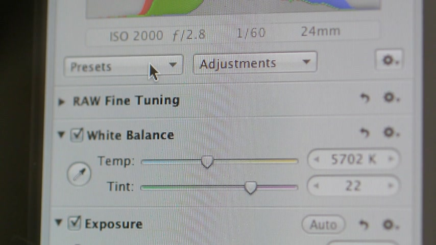 parlaklık : CALIFORNIA, UNITED STATES - CIRCA 2014: Apple Computers new desktop computer iMac with quick fixes for exposure, curves, brightness, contrast shadows and other presets RAW photo settings