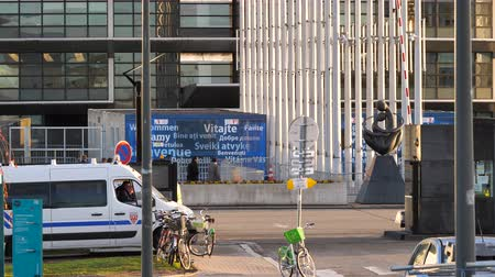 senate square : STRASBOURG, FRANCE - CIRCA 2018: People and cars entering exit the gate of European parliament in Strasbourg with CRS police van surveilling the crowd