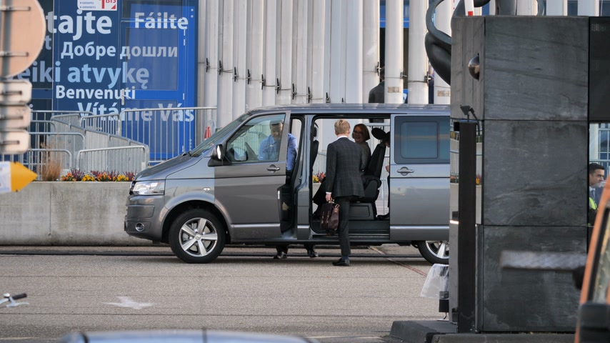 volkswagen : STRASBOURG, FRANCE - CIRCA 2018: MEPs parliamentarians visitor guest entering Volkswagen van leaving the European Parliament during the plenary session