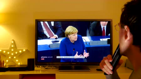 chancellor : STRASBOURG, FRANCE - NOV 13, 2018: Man approving following German Chancellor Angela Merkel debating the future of Europe with members of European Parliament