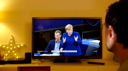bürokrasi : STRASBOURG, FRANCE - NOV 13, 2018: Man clapping hand after listening to German Chancellor Angela Merkel debating the future of Europe with members of European Parliament speech Stok Video