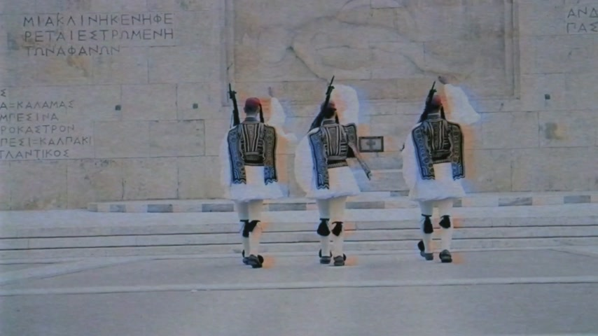 greek : Rear view of three unrecognizable Honor Evzones guard in front of  the Tomb of the Unknown Soldier at the Parliament Building in Syntagma Square vintage vhs effect applied Stock Footage