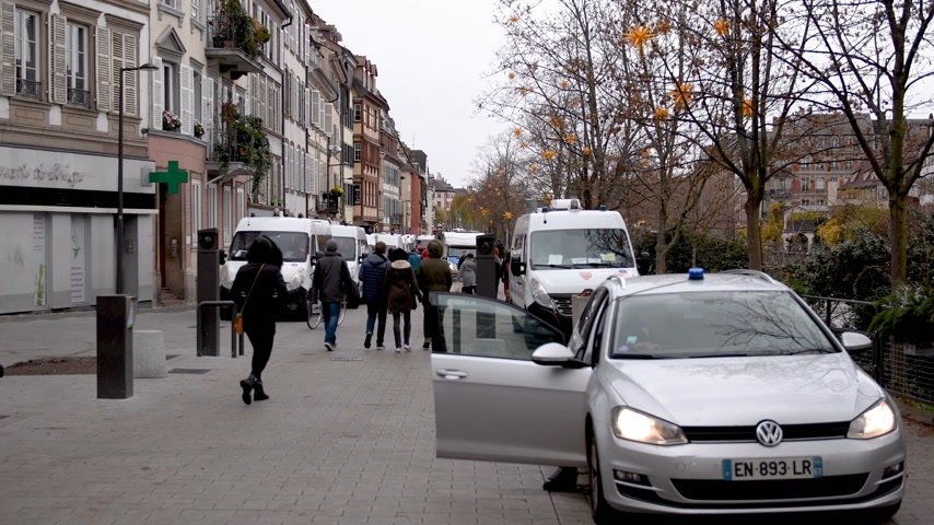increase : STRASBOURG, FRANCE - DEC 8, 2018: Tens of CRS French Police vans and officers securing the pedestrian street zone on Quai des Bateliers street protection against Yellow jackets during Christmas Market