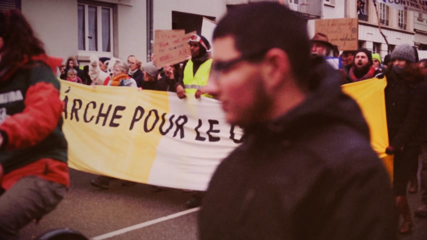 anti macron : STRASBOURG, FRANCE - DEC 8, 2018: Crowd marching in Central Strasbourg at the nationwide protest demonstration Marche Pour Le Climate - crowd yelling NON au GCO Grand Contournement Ouest de Strasbourg vhs vintage tape