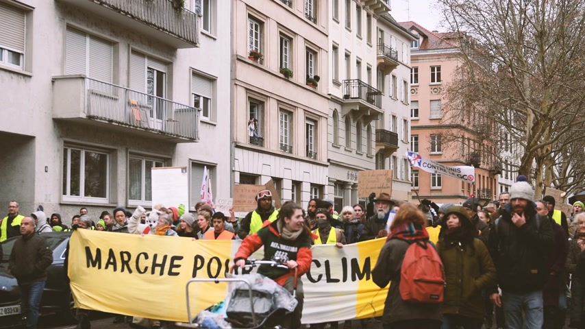 anti macron : STRASBOURG, FRANCE - DEC 8, 2018: Crowd marching in Central Strasbourg at the nationwide protest demonstration Marche Pour Le Climate - crowd yelling NON au GCO Grand Contournement Ouest de Strasbourg