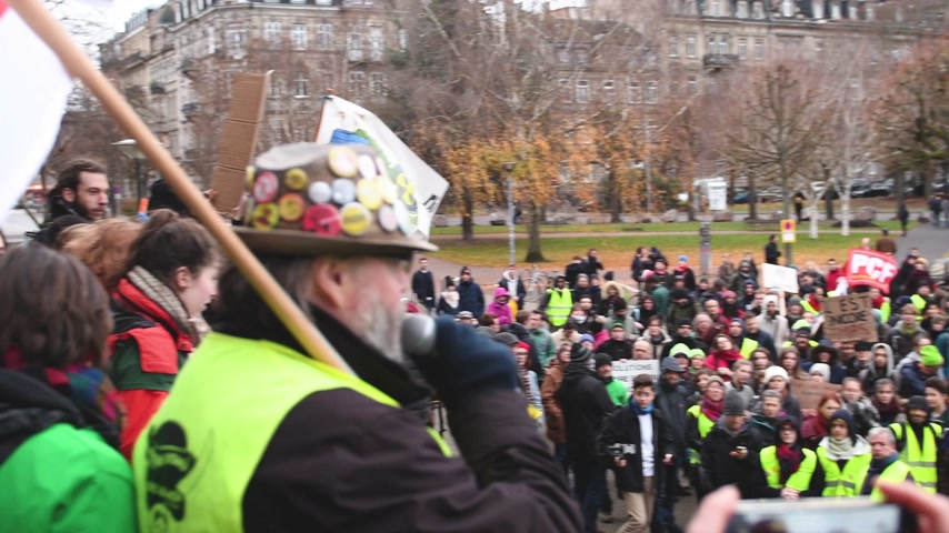 emmanuel macron : STRASBOURG, FRANCE - DEC 8, 2018: Man addressing to crowd the nationwide protest Marche Pour Le Climate in front of Strasbourg University speech against GCO Grand Contournement Ouest de Strasbourg