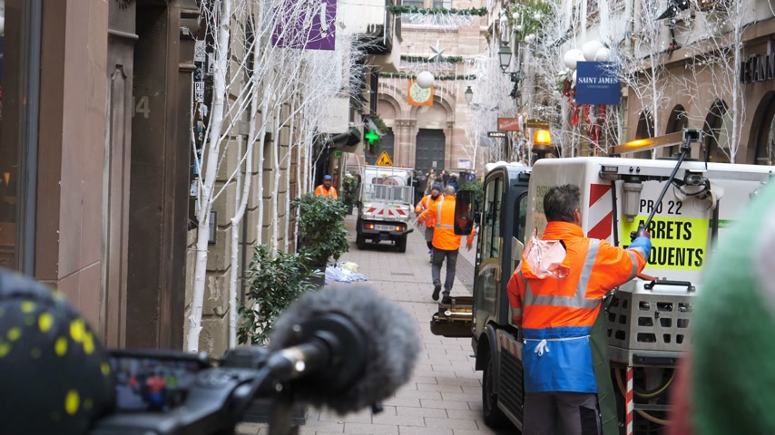 anti terrorism : STRASBOURG, FRANCE - DEC 11, 2018: Public services workers cleaning blood traces of terrorist attacks on Rue des Orfevres a day after Cherif Chekatt killed at least two people and wounded 12