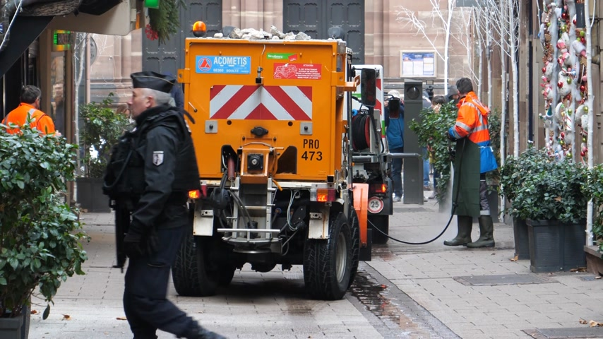 anti terrorism : STRASBOURG, FRANCE - DEC 11, 2018: Public services team cleaning blood traces of terrorist attacks on Rue des Orfevres a day after Cherif Chekatt killed at least two people and wounded 12