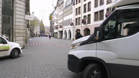anti terrorism : STRASBOURG, FRANCE - DEC 11, 2018: Delivery van in front of French Police officers securing Rue des Grandes Arcade in front of a crime scene after an attack in the Strasbourg Christmas market area Stock Footage