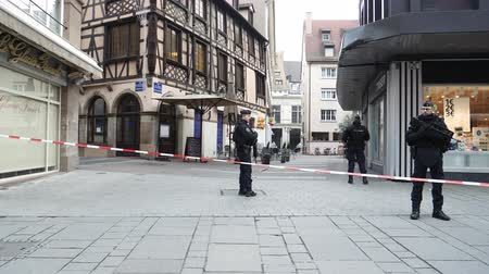 anti terrorism : STRASBOURG, FRANCE - DEC 11, 2018: Newsworthy French Police officers securing Rue du Saumon zone of a crime scene after an terrorist attack in the Strasbourg Christmas market area Stock Footage