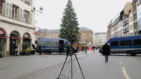 anti terrorism : STRASBOURG, FRANCE - DEC 11, 2018: Journalists in front of French Police officers securing Rue des Grandes Arcade after an attack in the Strasbourg Christmas market area - big fir tree