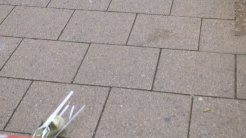anti terrorism : STRASBOURG, FRANCE - DEC 11, 2018: Tilt from flowers to crime scene area with blood traces of terrorist attacks on Rue des Orfevres a day after Cherif Chekatt killed at least two people and wounded 12