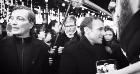 french president : STRASBOURG, FRANCE - DEC 14, 2018: Handheld video of smiling French President Emmanuel Macron shakes hands with members of a crowd at Christmas Market after paying tribute for victims of terrorist attack on 11 December