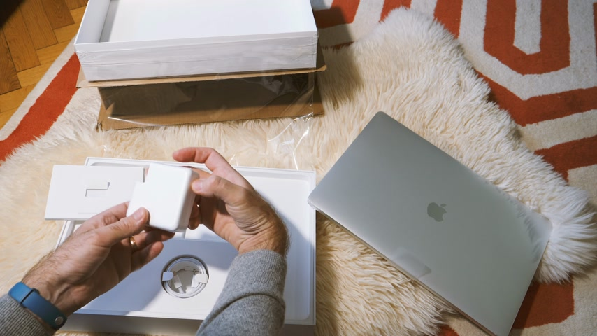 intel : Paris, France - Circa 2018: Professional unboxing unpacking latest Apple MacBook Pro 15 inch with Touch Bar with 32 GB RAM and Intel Core i9 certified refurbished white box with accesories