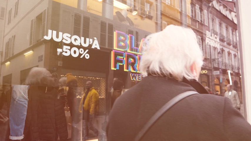 pitka : PARIS, FRANCE - CIRCA 2018: Black Friday consumerism with sale sign in the showcase store window of a modern shopping facade on a pedestrian street with reflection of customers people