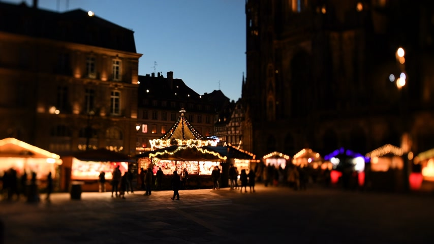 tilt shift : STRASBOURG, FRANCE - DEC 11 2018: Calm atmosphere before terrorist attack at Strasbourg Christmas market with people buying from market stalls, gifts, toys and sweets 4k UHD