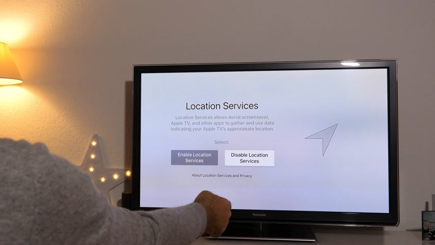 remote location : PARIS, FRANCE - NOV 2018: Disable location services and setting time zone on Apple TV 4K device by Apple Computers to Panasonic Plasma OLED tv in living room
