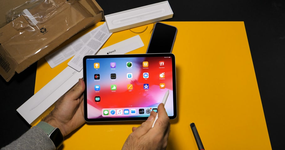 macintosh : PARIS, FRANCE - NOV 16, 2018: Man using Apple Watch and latest iPad Pro smart tablet device and Apple Pencil 2 in modern office environment Stock Footage