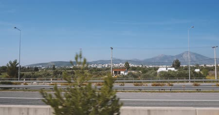 toll : ATHENS, GREECE - CIRCA 2018: View from the train window to the almost empty Attiki Odos highway with view to mountains with bulletproof executive luxury Mercedes-Benz Sprinter black van