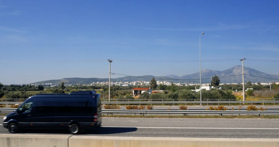 toll : ATHENS, GREECE - CIRCA 2018: Summer in Greece and Attiki Odos highway with view to mountains approaching to the Athens International Airport