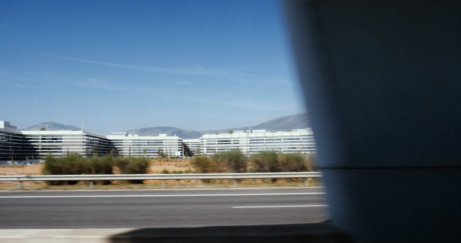athens : ATHENS, GREECE - CIRCA 2018: View from the train window to the almost empty Attiki Odos highway privately owned toll motorway to business park building Stock Footage