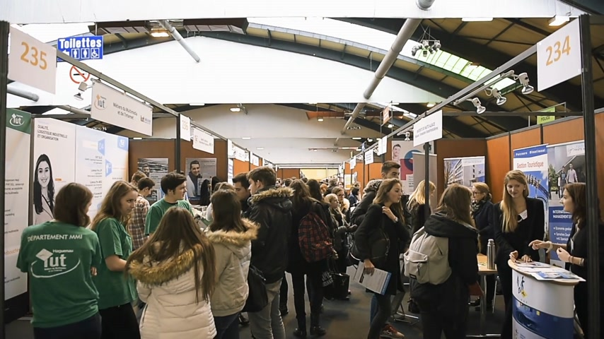 subject : STRASBOURG, FRANCE - CIRCA 2018: Rows of stands with children and teens of all ages attending annual Education Fair to choose career path and receive vocational counseling
