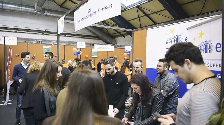 all ages : STRASBOURG, FRANCE - CIRCA 2018: Children and teens of all ages attending annual Education Fair to choose career path and receive vocational counseling - Private Economical School