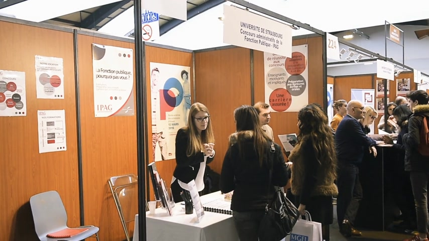 all ages : STRASBOURG, FRANCE - CIRCA 2018: Children and teens of all ages attending annual Education Fair at stand of Concours administratifs de la fonction publique
