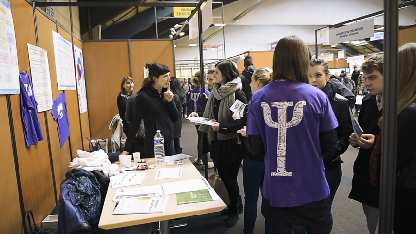 all ages : STRASBOURG, FRANCE - CIRCA 2018: Children and teens of all ages attending annual Education Fair to choose career path and receive vocational counseling at university stand Stock Footage