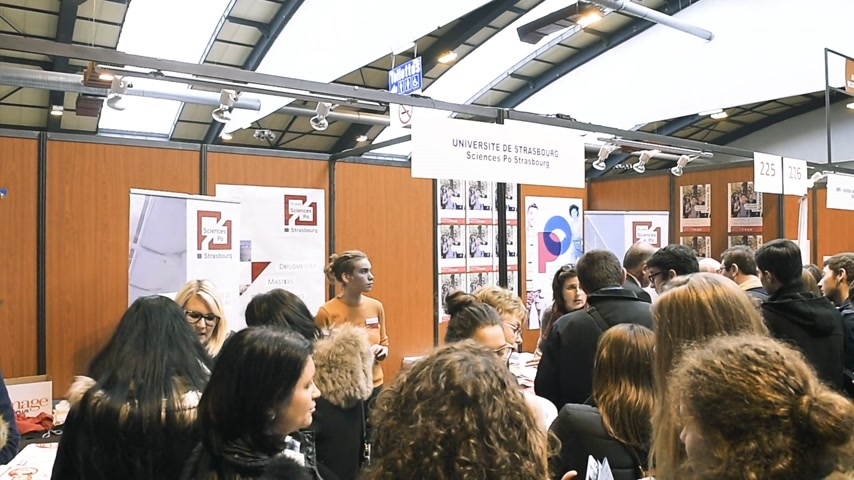 subject : STRASBOURG, FRANCE - CIRCA 2018: Children and teens of all ages attending annual Education Fair to choose career path and receive vocational counseling - Sciences Po stand
