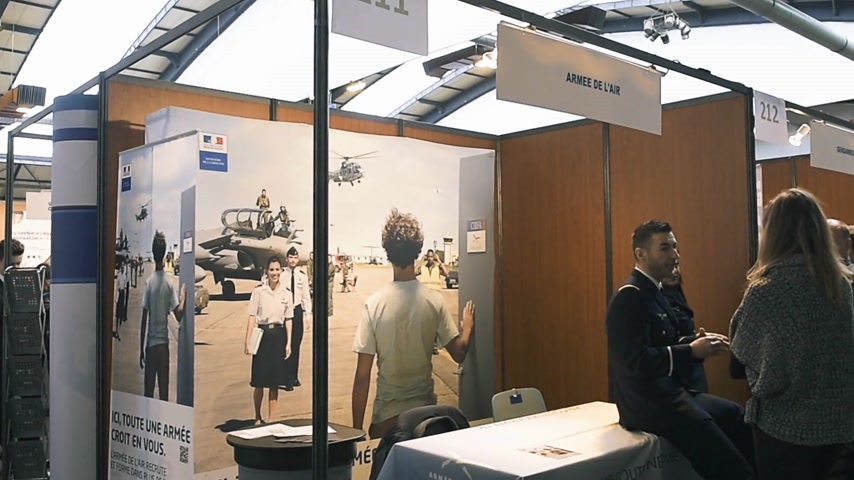 all ages : STRASBOURG, FRANCE - CIRCA 2018: Children and teens of all ages attending annual Education Fair to choose career path and receive vocational counseling - Air army stand