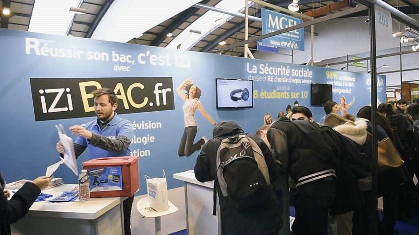 all ages : STRASBOURG, FRANCE - CIRCA 2018: Children and teens of all ages attending annual Education Fair to choose career path and receive vocational counseling izibac.fr stand