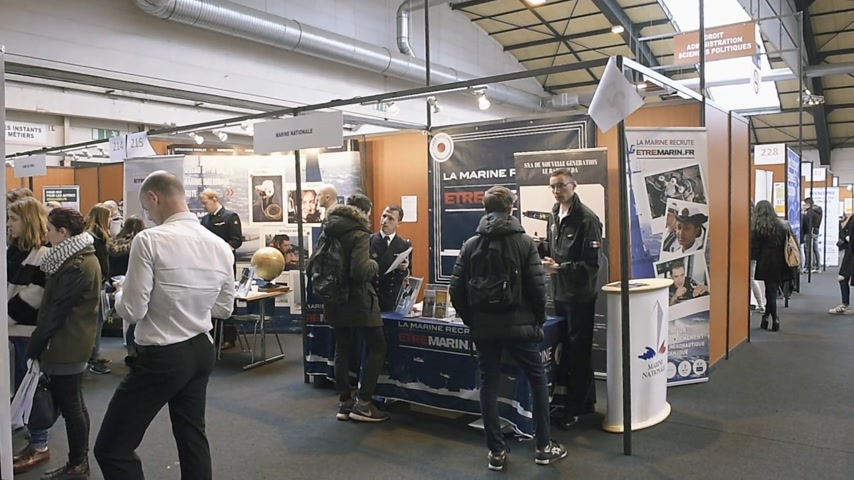 all ages : STRASBOURG, FRANCE - CIRCA 2018: Children and teens of all ages attending annual Education Fair to choose career path and receive vocational counseling Marine Navy etre Marin stand