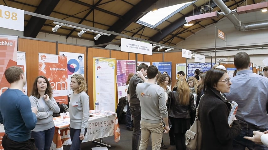 choosing path : STRASBOURG, FRANCE - CIRCA 2018: Strasbourg business school stand with young people attending annual Education Fair to choose career path and receive vocational counseling
